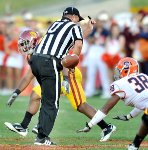 The official gets in the way of a pass intended for Southern California running back Marc Tyler (26) in the 3rd quarter. The USC Trojans defeated the Orangemen of Syracuse 38 to 17 in a game played at the Coliseum in Los Angeles, CA. 9-17-2011. (John McCoy/Staff Photographer)