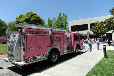 """The fire trucks from the The Pink Heals Tour at Henry Mayo Newhall Memorial Hospital to show support for women that have been affected by cancer Tuesday, May 10, 2011. The Guardians of the Ribbon"""" are firefighters, police officers and community leaders from around the country dedicated to the fight against all types of cancer affecting women. For more information go to http://www.pinkfiretrucks.org/ (Hans Gutknecht/Staff Photographer)"""