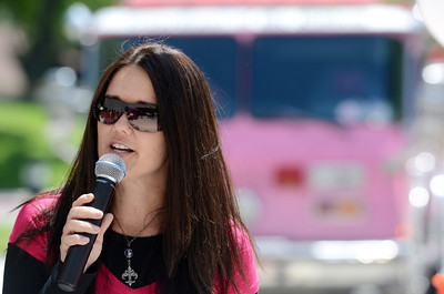 """Sheri Clement, who is battling cancer, speaks during the The Pink Heals Tour at Henry Mayo Newhall Memorial Hospital. The pink fire trucks were at the hospital to show support for women that have been affected by cancer Tuesday, May 10, 2011. The Guardians of the Ribbon"""" are firefighters, police officers and community leaders from around the country dedicated to the fight against all types of cancer affecting women. (Hans Gutknecht/Staff Photographer)"""