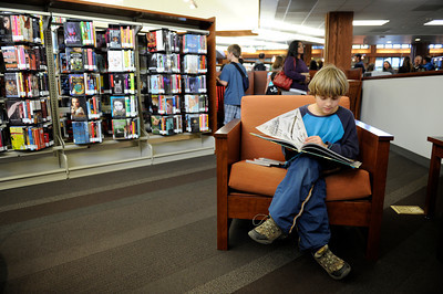 Elias Klemp, 9-years-old, reads a book  during opening day for the new County of Los Angeles Topanga Library at 122 N. Topanga Canyon Blvd. in Topanga. (Hans Gutknecht/Staff Photographer)