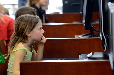 Topanga Elementary School third grader Sidney Brody, 8-years-old, reads a computer screen during opening day for the new County of Los Angeles Topanga Library at 122 N. Topanga Canyon Blvd. in Topanga. (Hans Gutknecht/Staff Photographer)