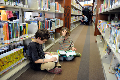 Harrison Erickson, 8-years-old, and brother Erikson, 4-years-old, check out some books  during opening day for the new County of Los Angeles Topanga Library at 122 N. Topanga Canyon Blvd. in Topanga. (Hans Gutknecht/Staff Photographer)