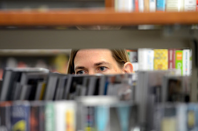 Claire Chapman looks over some books  during opening day for the new County of Los Angeles Topanga Library at 122 N. Topanga Canyon Blvd. in Topanga. (Hans Gutknecht/Staff Photographer)