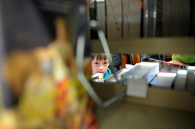 Quinlan O'Driscoll, 7-years-old, looks at books during opening day for the new County of Los Angeles Topanga Library at 122 N. Topanga Canyon Blvd. in Topanga. (Hans Gutknecht/Staff Photographer)