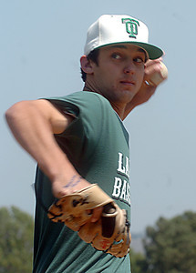 Thousand Oaks High School baseball pitcher, Matt Bywater practices on Wednesday, May 16, 2007 for playoffs beginning this week. (Tina Burch/Staff Photographer)