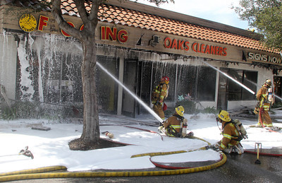 A fire broke out at a dry cleaning business in Thousand Oaks on Wednesday, taking dozens of firefighters nearly two hours to put the flames out. The blaze also damaged several other businesses in the strip mall at 2524 E. Thousand Oaks Blvd., according to the Ventura County Fire Department. Flames were reported at about 11:34 a.m. and were doused by about 1:30 p.m. One of the business owners sustained minor injuries, but refursed medical transport, according to the fire department. The cause of the fire was under investigation.   Photo by Morris Cohen