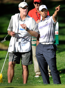 Joe LaCava and Tiger Woods on the 16th green. The Chevron World Challenge put Sherwood Country Club on display during the Pro-am round. Thousand Oaks, CA 11/30/2011(John McCoy/Staff Photographer)