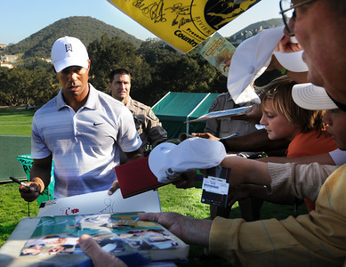Tiger Woods signs autographs after the round. The Chevron World Challenge put Sherwood Country Club on display during the Pro-am round. Thousand Oaks, CA 11/30/2011(John McCoy/Staff Photographer)