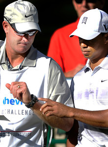 Tiger Woods and his caddy Joe LaCava take a look at the time on the 16th green. The Chevron World Challenge put Sherwood Country Club on display during the Pro-am round. Thousand Oaks, CA 11/30/2011(John McCoy/Staff Photographer)