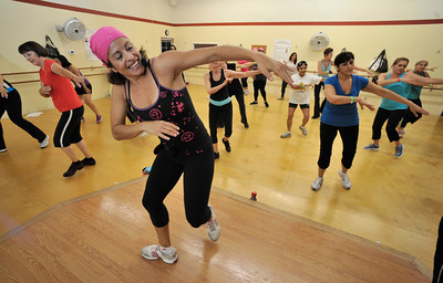 Sandy Riebeck leads a Zumba class. Riebeck (cq) is the owner of a small fitness buisness that has big plans and is growing. Time 4 Class will soon open one of the largest workout rooms in the San Fernando Valley for Zumba classes. Chatsworth, CA 9/28/2001(John McCoy/Staff Photographer)