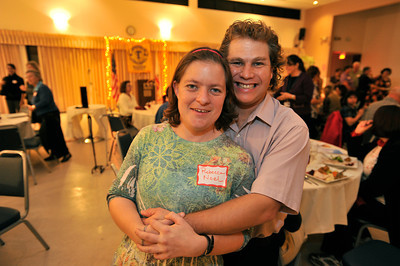 Rebecca Noel and her boyfriend Christian Beasley. New Horizons in North Hills teamed up with Toastmasters International to provide developmentaly disabled adults the opprotunity to participate in speech making. 24 clients from New Horizons gathered for dinner and speeches in the dining room on the topic of Thanksgiving. North Hills, CA.11-17-2010. (John McCoy/staff photographer)