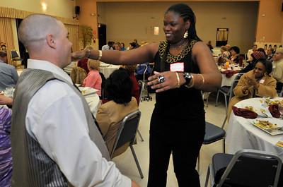 Edward Harding gets a hug from his girlfriend Symone Coleman after he finished his speech. New Horizons in North Hills teamed up with Toastmasters International to provide developmentaly disabled adults the opprotunity to participate in speech making. 24 clients from New Horizons gathered for dinner and speeches in the dining room on the topic of Thanksgiving. North Hills, CA.11-17-2010. (John McCoy/staff photographer)