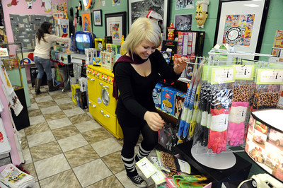 Jill Jones and Lucy Levinsohn stock merchandise at Big Kid Collectable Toy Mall and Retro Store in Sherman Oaks, CA. (Hans Gutknceht/Staff Photographer)