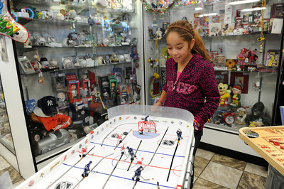 Kassandra Cook plays a game at Big Kid Collectable Toy Mall and Retro Store in Sherman Oaks, CA. (Hans Gutknceht/Staff Photograph