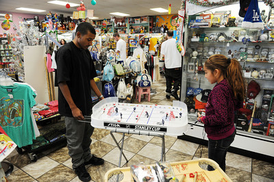 Ethan Benn and Kassandra Cook play a game at Big Kid Collectable Toy Mall and Retro Store in Sherman Oaks, CA. (Hans Gutknceht/Staff Photographer)