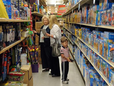 Neil Yeich, 3-years-old, shops with his mother Cathy and grandmother Mary Anne Henkel at Tom's Toys in Montrose, CA. (Hans Gutknceht/Staff Photographer)
