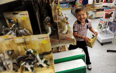 Neil Yeich, 3-years-old, shops with his mother and grandmother at Tom's Toys in Montrose, CA. (Hans Gutknceht/Staff Photographer)