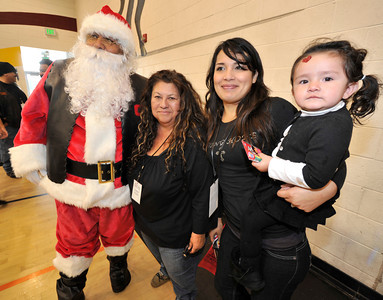 The LAPD Mission Division and LAPD Centurions have partnered with Project Living Hope, several motorcycle clubs and hundreds of volunteers and sponsors to help bring toys, food, entertainment and support to needy children and families in the San Fernando Valley. Thousands gathered at Vista Middle School in Panorama City to allow children to pick out gifts for themselves to celebrate the holidays. Panorama City, CA 12-18-2010. (John McCoy/staff photographer)