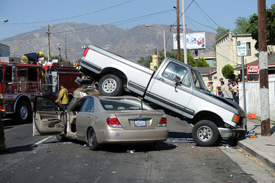 Los Angeles Fire Department at the scene of a traffic collision Tuesday, August 30th, 2011 in the 13200 block of Mclay Ave in Sylmar, CA.  The truck was unoccupied at the time of the collision with only one victim being transported. (Hans Gutknecht/Staff Photographer)