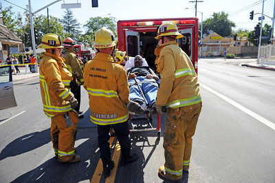 Los Angeles Fire Department personnel prepare to transport a man to a local hospital after the car he was driving was involved in an collision Tuesday, August 30th, 2011 in the 13200 block of Mclay Ave in Sylmar, CA.  The truck was unoccupied at the time of the collision with only one victim being transported. (Hans Gutknecht/Staff Photographer)
