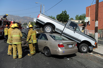Los Angeles Fire Department at the scene os a traffic collision Tuesday, August 30th, 2011 in the 13200 block of Mclay Ave in Sylmar, CA.  The truck was unoccupied at the time of the collision with only one victim being transported. (Hans Gutknecht/Staff Photographer)