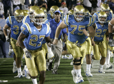 UCLA's players with coach Dorrell runs onto the field to start the second half of the game against Notre Dame on Saturday, Oct. 6, 2007 at Rose Bowl. (Edna T. Simpson)