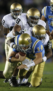 UCLA's McLeod Bethel-Thompson gets tackle by Notre Dame's Kerry Neal and Trevor Laws during the second quarter on Saturday, Oct. 6, 2007 at Rose Bowl. (Edna T. Simpson)