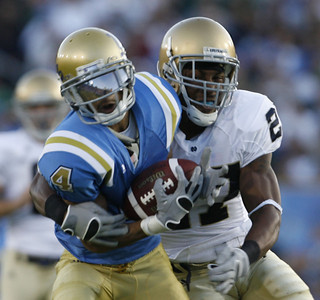 UCLA's Terrence Austin gains yardage before getting tackled by Notre Dame  David Bruton during the first half on Saturday, Oct. 6, 2007 (Edna T. Simpson)