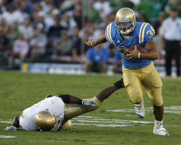 UCLA's  Kahill Bell breaks away from Notre Dame  Maurice Crum during the first half on Saturday, Oct. 6, 2007 at Rose Bowl. (Edna T. Simpson)