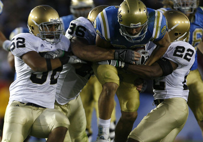 UCLA's Joe Cowan gets tackled by Notre Dame's defense during the first half on Saturday, Oct. 6, 2007 at Rose Bowl. (Edna T. Simpson)