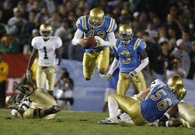 UCLA's  Aaron Whittington jumps up high in the air after recovering the ball, but the play was called back during the third quarter on Saturday, Oct. 6, 2007 against Notre Dame. (Edna T. Simpson)