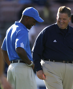 UCLA's Head Coach Karl Dorrell talks with Notre Dame Head Coach Charlie Weis before the game on Saturday, Oct. 6, 2007 at Rose Bowl. (Edna T. Simpson)