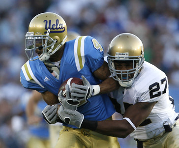 UCLA's Terrence Austin gains yardage before getting tackled by Notre Dame David  Bruton during the first half on Saturday, Oct. 6, 2007 at Rose Bowl. (Edna T. Simpson)