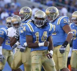 UCLA's Chris Horton celebrates after making a hard tackle on Notre Dame's James Aldridge during the first quarter on Saturday, Oct . 6, 2007. (Edna T. Simpson)
