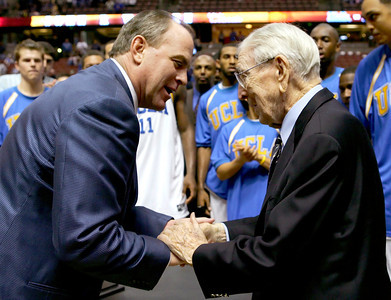 Head coach Ben Howland of the UCLA Bruins greets John Wooden after defeating the Nevada Wolf Pack at the 12th Annual John R. Wooden Classic on December 10, 2005 at The Arrowhead Pond of Anaheim in Anaheim, California. The Bruins won 67-56.  (Photo by Lisa Blumenfeld/Getty Images)