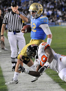 Bruins QB Richard Brehaut is hit late, out of bounds, by Oregon #59 Dwight Roberson. A penalty was called on the play. The Bruins of UCLA defeated the Oregon State Beavers in a game played in the Rose Bowl 17-14 on a last second fieldgoal by Kai Forbath. Pasadena, CA.11-6-2010. (John McCoy/staff photographer)