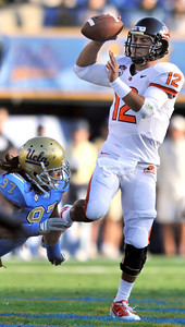 Bruins #97 Damien Hlmes puts preasure on #12 Ryan Katz in the first half. The Bruins of UCLA defeated the Oregon State Beavers in a game played in the Rose Bowl 17-14 on a last second fieldgoal by Kai Forbath. Pasadena, CA.11-6-2010. (John McCoy/staff photographer)