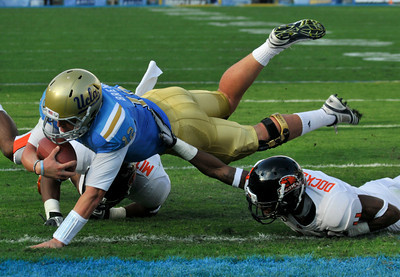 Richard Brehaut scores the first points of the game in the first half. The Bruins of UCLA defeated the Oregon State Beavers in a game played in the Rose Bowl 17-14 on a last second fieldgoal by Kai Forbath. Pasadena, CA.11-6-2010. (John McCoy/staff photographer)