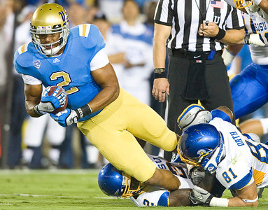 UCLA running back Anthony Barr advances the Bruins a yard, leading to UCLA running back Johnathan Franklin's touchdown. UCLA faced San Jose State on Saturday, Sept. 10, 2011 at the Rose Bowl in Pasadena, Calif. during the Bruins' home opener. At the half, UCLA leads SJSU 14-7, with touchdowns by running back Johnathan Franklin and UCLA tight end Joseph Fauria.  (Maya Sugarman/Staff Photographer)