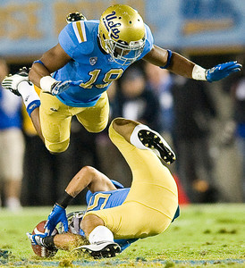 UCLA safety Dalton Hilliard dives over UCLA safety Alex Mascarenas, as Mascarenas attempts an interception. The pass was ruled incomplete. UCLA defeated San Jose State 27-17 on Saturday, Sept. 10, 2011 at the Rose Bowl in Pasadena, Calif. during the Bruins' home opener.  (Maya Sugarman/Staff Photographer)