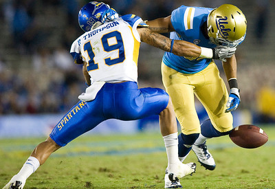 UCLA wide receiver Taylor Embree fumbles a pass from UCLA quarterback Richard Brehaut at the SJSU 19 yard line. UCLA defeated San Jose State 27-17 on Saturday, Sept. 10, 2011 at the Rose Bowl in Pasadena, Calif. during the Bruins' home opener.  (Maya Sugarman/Staff Photographer)