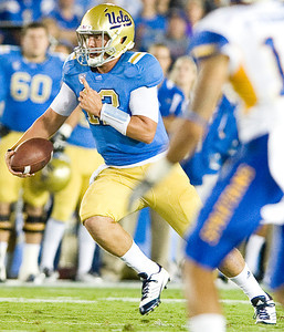 UCLA quarterback Richard Brehaut runs for a first down after the Bruins were 3rd and 10. The possession led to UCLA's first touchdown. UCLA faced San Jose State on Saturday, Sept. 10, 2011 at the Rose Bowl in Pasadena, Calif. during the Bruins' home opener. At the half, UCLA leads SJSU 14-7, with touchdowns by running back Johnathan Franklin and UCLA tight end Joseph Fauria.  (Maya Sugarman/Staff Photographer)