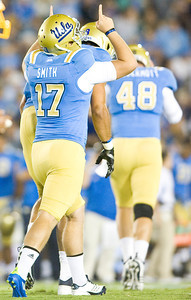 UCLA kicker Kip Smith reacts after scoring the extra point after UCLA running back Johnathan Franklin's touchdown. Smith struggled during their season opener against Houston, missing a 30-yard field goal. UCLA faced San Jose State on Saturday, Sept. 10, 2011 at the Rose Bowl in Pasadena, Calif. during the Bruins' home opener. At the half, UCLA leads SJSU 14-7, with touchdowns by running back Johnathan Franklin and UCLA tight end Joseph Fauria.  (Maya Sugarman/Staff Photographer)