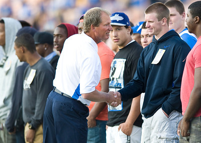 Coach Rick Neuheisel greets recruits as the Bruins warm up for their home opener. UCLA faced San Jose State on Saturday, Sept. 10, 2011 at the Rose Bowl in Pasadena, Calif. during the Bruins' home opener. At the half, UCLA leads SJSU 14-7, with touchdowns by running back Johnathan Franklin and UCLA tight end Joseph Fauria.  (Maya Sugarman/Staff Photographer)