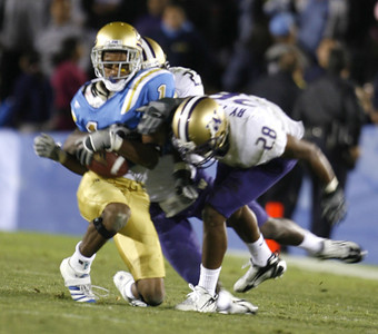 UCLA's Brandon Breazell  gets tackled by Washington's Roy Lewis during the game on Saturday, September 23, 2007 at Rose Bowl. (Edna T. Simpson)