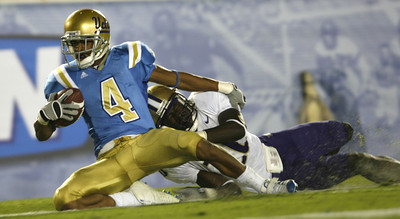 UCLA's Terrence Austin makes it in for a touchdown  as  Washington's Jason Wells failed to make the tackle during the second quarter on Saturday, September 22, 2007 at Rose Bowl. (Edna T. Simpson)