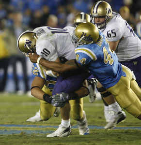 UCLA's Bruce Davis sacked Washington's QB Jake Locker during the fourth quarter on Saturday, September 22, 2007 at Rose Bowl. (Edna T. Simpson)