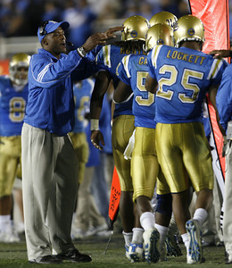UCLA's  Karl Dorrell celebrates with his players after Dennis Keys made a touchdown during the third quarter on Saturday, September 22, 2007 against Washington. (Edna T. Simpson)