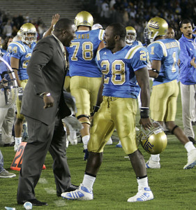 UCLA's Chris Markey celebrates with a sports announcer on the sidelines after making a touchdown in the fourth quarter on Saturday, September 22, 2007 against Washington. (Edna T. Simpson)