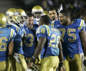 UCLA's Chris Markey celebrates with teammates after making a touchdown in the fourth quarter on Saturday, September 22, 2007 against Washington. (Edna T. Simpson)